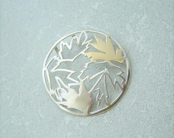 925 Sterling Silver Circular Cut Out Leaf Pendant