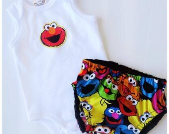 Size 000 Elmo and Sesame Street, Newborn Onsie & Nappy cover baby shower Gift set