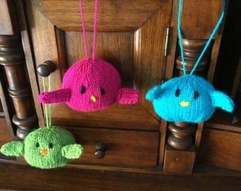 3 flying knitted birdies