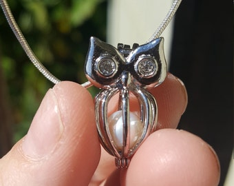 Cute Owl pendant with cultured pearl inside