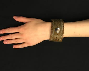 Leather bracelet made from old belt.