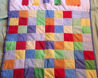 Bold colour train patchwork quilt