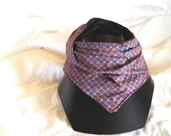 Purple bandana bib, geometric pattern