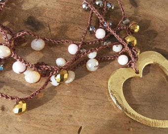 Long necklace with crystals and gold heart