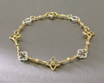 Gold and Silver bracelet.