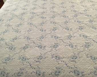 Machine embroidered king reversible quilt in blue