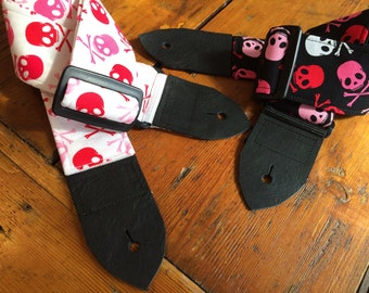 Skull and crossbones guitar strap -- red and pink on white or black background