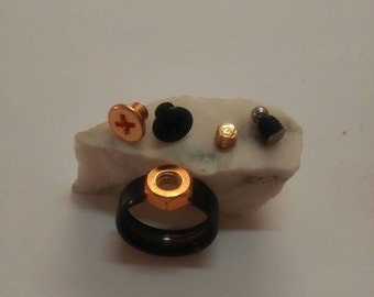 charm ring with interchangeable top made from skateboard bearing