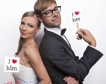 """Props for photocall of """"I love her"""" and """"I love him"""""""