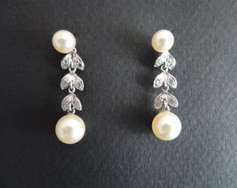 White gold earrings, pearls and rose cut diamnds.