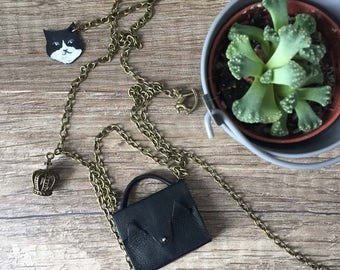 """Collier """"mini sac chacha noir"""" chaine bronze"""