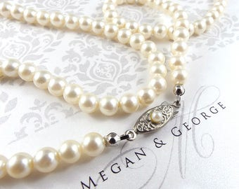 Pearl necklace faux, pearls, costume pearl necklace, vintage faux pearls, faux pearls, old pearls vintage, costume jewellery.
