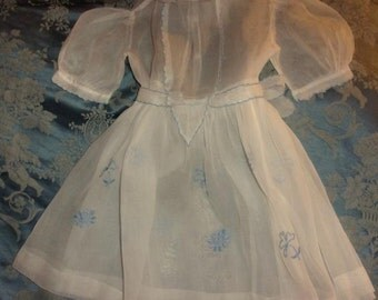 A lovely old kid hand embroidered dress