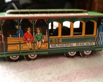 Vintage tin friction powered municipal railway trolley car 1950s
