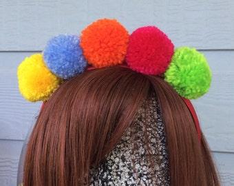 Brightly coloured pompom headband