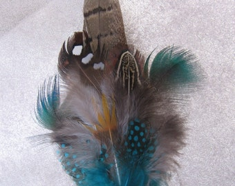 Feather pin, brooch, corsage