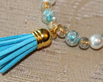 A Stunning Blue Stretch Bracelet with a Tassel