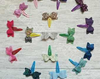 2.5inch fabric bow clip. Choose 2.   Can be matched or different.