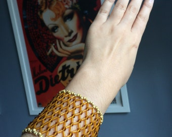 Geometric golden beaded bracelet handmade