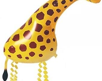 Giraffe walking floating helium balloon