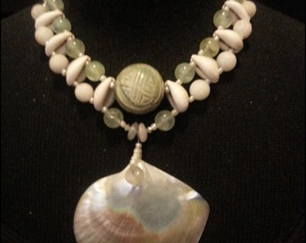Stunning MOP shell focal, fresh water pearls, semi-precious stones and cowrie shells
