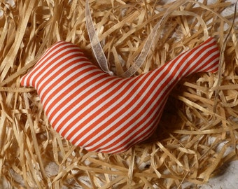 Red white striped bird for the Easter bouquet