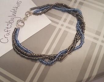 3 string silver and blue bracelet A27