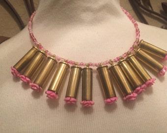 Dozen pink roses bullet casings choker