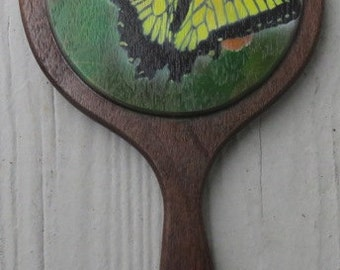 Black walnut hand mirror with painted Swallow tail butterfly.