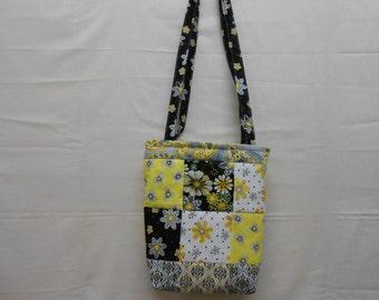 Spring handbag with over the shoulder handles yellow and black flowered blocks,pockets inside.