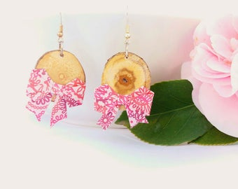 Lightweight Earrings with pink and fucsia geometric patterned origami bows that enhance two disks of different woods varnished