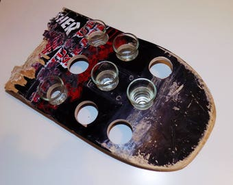 Shot glass holder with drinking game of skateboard