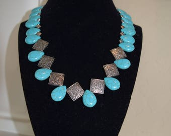 Turquoise Teardrop with Diamond shaped Silver Beads