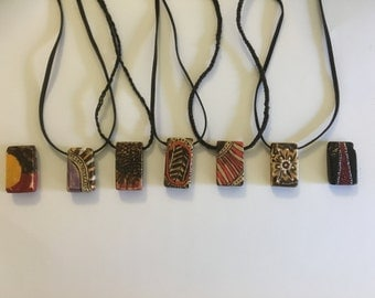Woodburned and painted necklace pendant.
