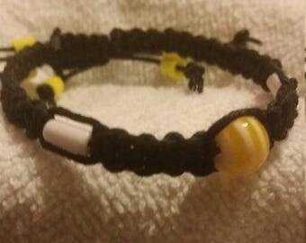 Yellow/White Acrylic Bead on Black Hemp cord