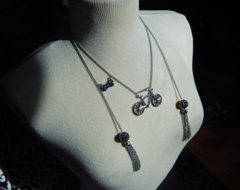 Silver bicycle bow tasle necklace