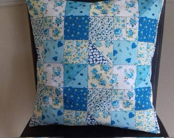 "16"" × 16"" blue patchwork cushion cover."