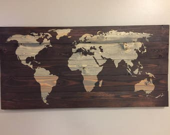 World map made with reclaimed wood.