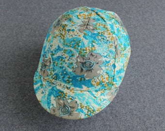 Floral cycling cap with turquoise lining