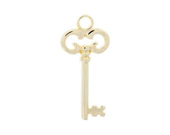 Pendant key with bath of gold 24kt. 55 * 25 mm.