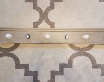 Repurposed baseboard coat rack