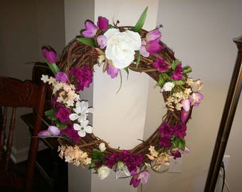 Decorative Grapevine Wreath with silk roses and other summer flowers.