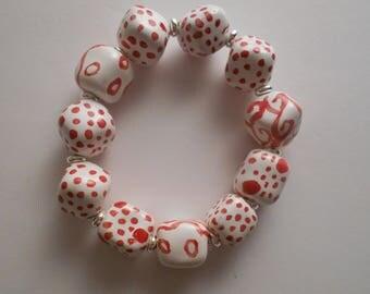 Lovely Kazuri ceramic fair trade bead bracelet in white with red designs