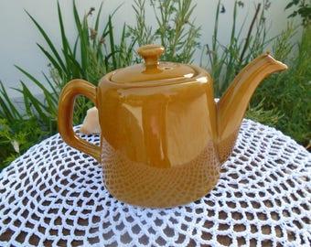 Caramel colored porcelain teapot - teapot used in bars