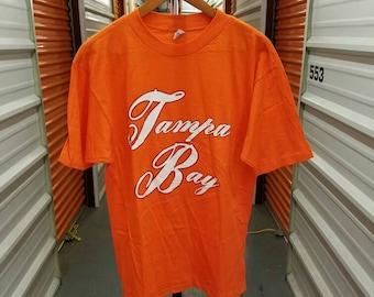 Vintage 80's Original Tampa Bay Buccaneers T-Shirt By Artex. Men's Size Large.