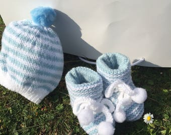 Blue hand knitted baby bootees with matching hat