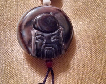 Two-sided amulet with beads necklace.