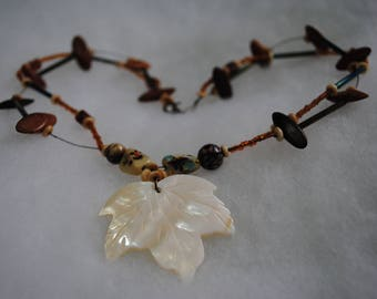 Handmade Necklace with wood and glass beads and an ivory shell leaf pendant