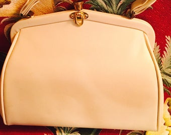 1960's Bone color vinyl handbag.