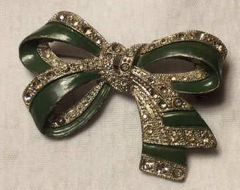 Vintage green and silver rhinestone bow brooch